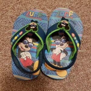 Mickey mouse flip flops.